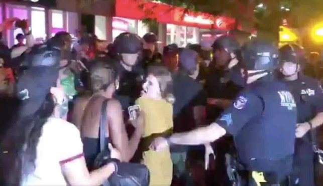 NYPD cop orders screaming leftist to 'back up!' She jumps right in his face and yells, 'or f***ing what?' Police show her what.