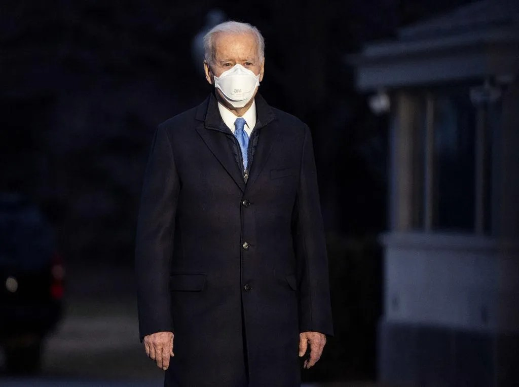 Biden tells Americans to wear face masks until 2022 just months after saying they'd only need them until April