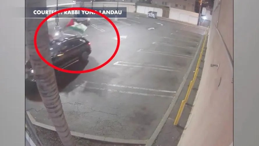 Surveillance video shows Jewish man being chased down by cars waving Palestinian flags. He says he ran for his life as they began shouting 'Allahu akbar!'