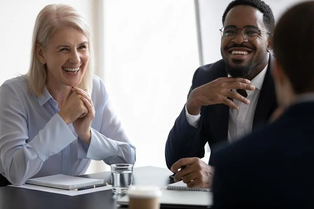 Middle aged professionals happy at work after changing careers