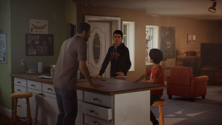 The Diaz family stand and sit around the kitchen island in their home