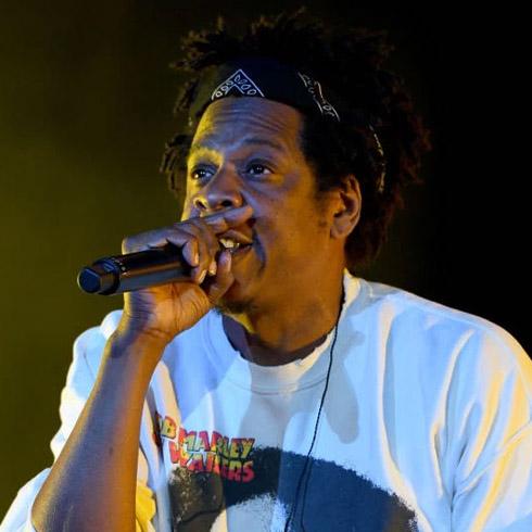 Jay Z singing into a mic