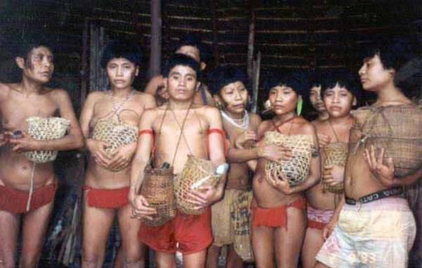Survivors of Brazil's 1993 Haximu massacre hold urns containing the ashes of their relatives. Goldminers killed 16 Yanomami in the attack.