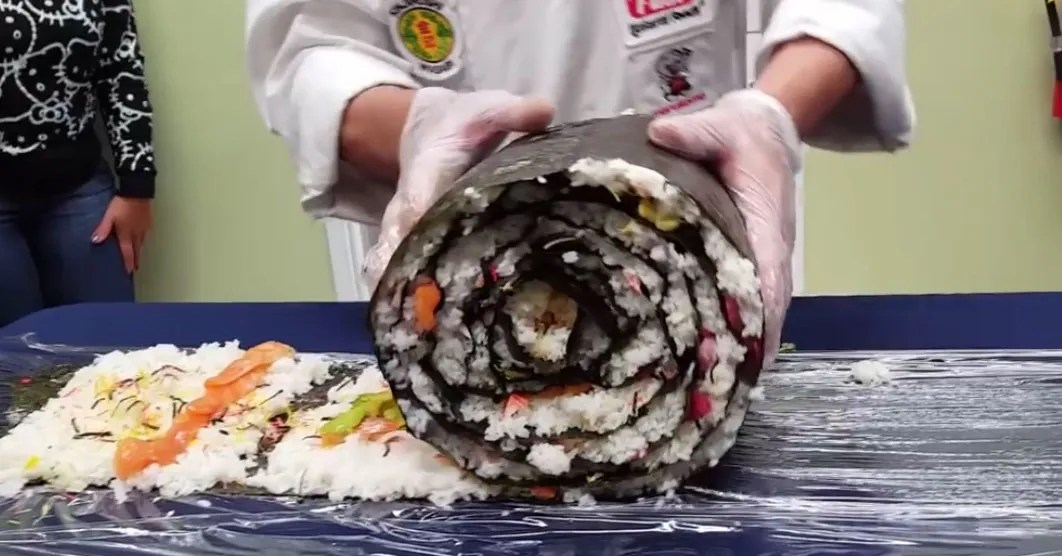 Watch These Chefs Make A Giant Sushi Roll And Cut It With