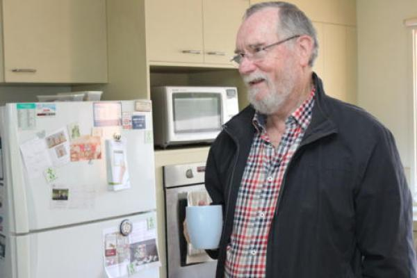 """Peter Latham, who helped initiate and fund a community housing program in Croydon. """"We have four refugee families, single mums with kids, single people with disabilities, and low income people."""""""