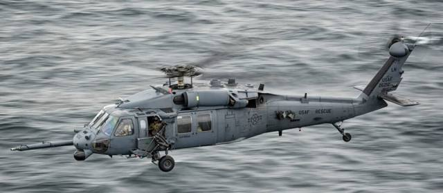 A Pave Hawk crew scoots at low level over the ocean towards RAF Lossiemouth after practicing and refining tactics on Tain Range during the Joint Warrior 16-1 exercise.
