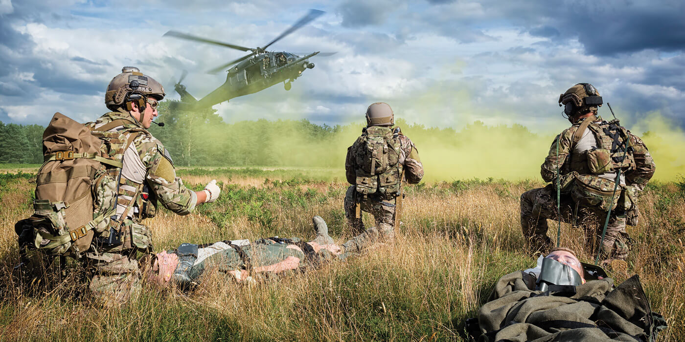 USAF pararescuemen from the 57th Rescue Squadron take a knee as a 56th Rescue Squadron HH-60G Pave Hawk clears smoke at the landing zone. Photos by Lloyd Horgan/Vortex Aeromedia