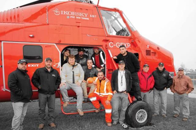 The Sprint and Four Seasons teams relax after completing the S-58ET's first lift job. The two companies have established a close working relationship over the past four years.
