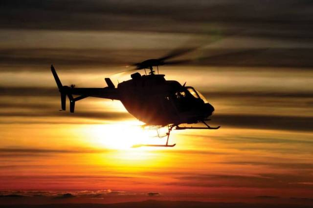 A Platinum Helicopteros Bell 407 returns to base with a setting sun behind it. The operator has bases in Santiago and Concepción, Chile. Anthony Pecchi Photos