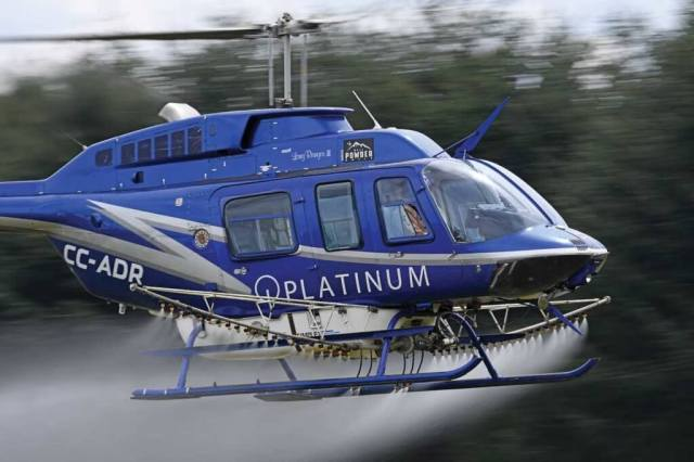 The company's Bell 207L is fitted with a Simplex spray system for agricultural spraying operations.