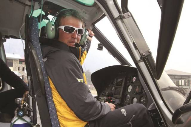 Simone Moro sits in helicopter