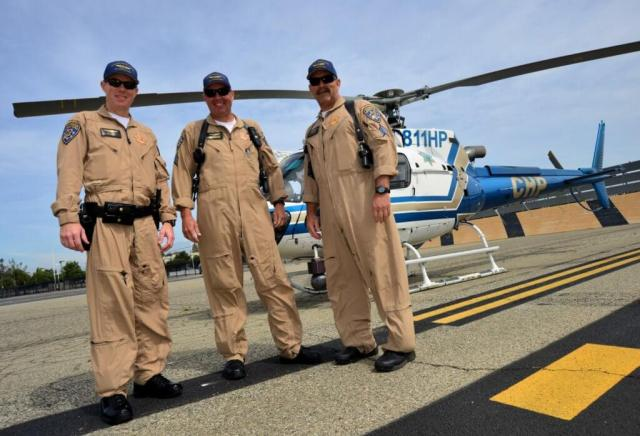 An Apple Valley-based California Highway Patrol crew pose for the camera in front of their Airbus AS350 B3. Skip Robinson Photo
