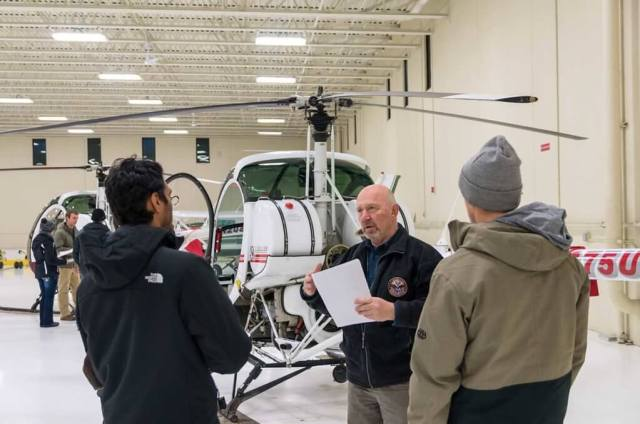 Chief helicopter pilot Ron Depue gives a group briefing on a preflight.