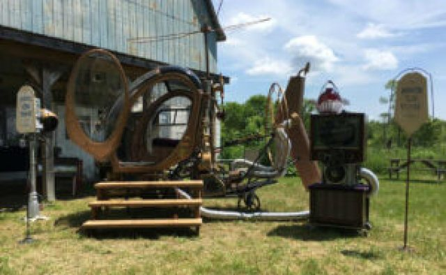 "The couple even created a beautiful ""time machine"" art piece out of a helicopter and helicopter parts."