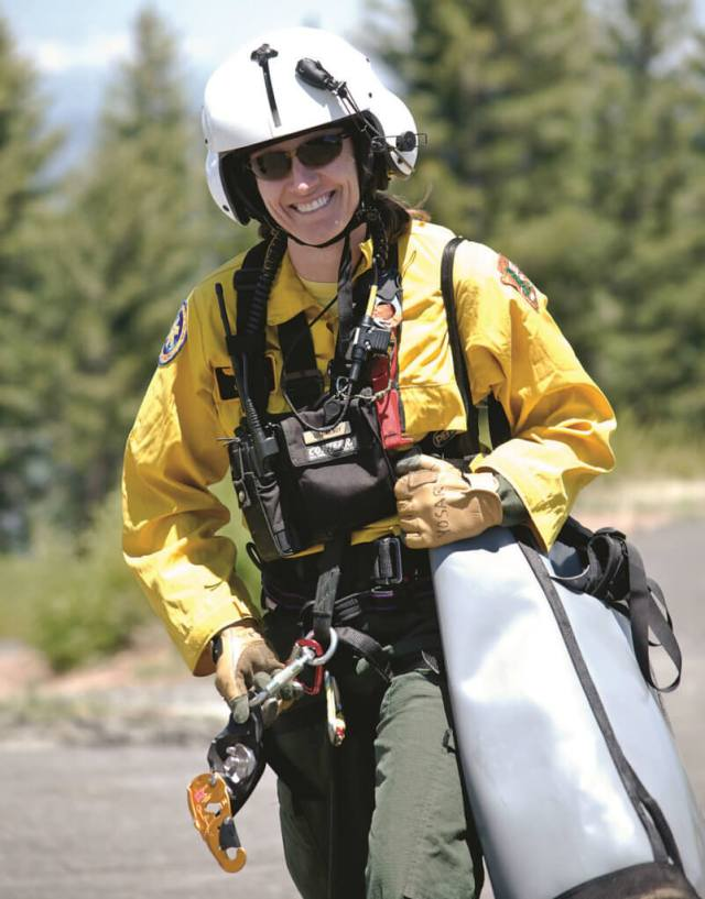 Lisa Hendy walks to the helibase for another rappel.