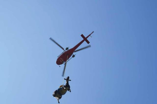 Swiss Helicopter gets called to assist cows that have become stuck in the hillsides around Gsteigwiler about 200 times a year. Oliver Johnson Photo