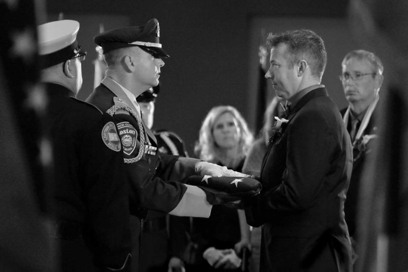 Firefighter Jim Foster accepts the flag for his late fiancée Tiffany Urresti at the National EMS Memorial Service earlier this year. Mark Mennie Photo