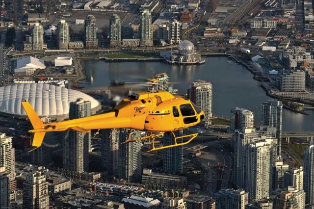 An Airbus AS355 TwinStar, operated by Talon Helicopters, flies over downtown Vancouver, B.C. Talon president Peter Murray said that while Nav Canada does listen to helicopter operator's concerns, the organization is airline-focused. Graham Lavery Photo