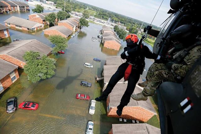 Brian Archibald, a rescue specialist assigned to the South Carolina Helicopter Aquatic Rescue Team Delta, is lowered to flood waters in Port Arthur. Staff Sgt. Daniel Martinez Photo