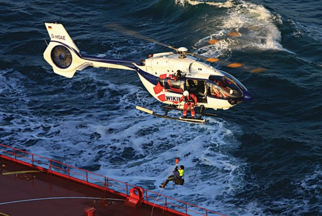 Wiking Helikopter Service H145 flies over water