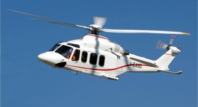 Leonardo Helicopters AW139 hovering in blue sky.