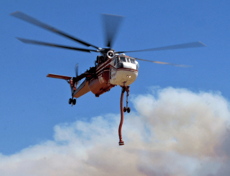 A Sikorsky CH-54B Skycrane displaying its intake hose at a previous AFF North America event. Aerial Firefighting North America Photo