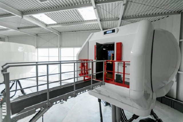The simulator comprises a 6 DOF-electric motion and vibration system, directly projected moving imagery, and an intuitive on board instructor operating station. Christoph Papsch Photo