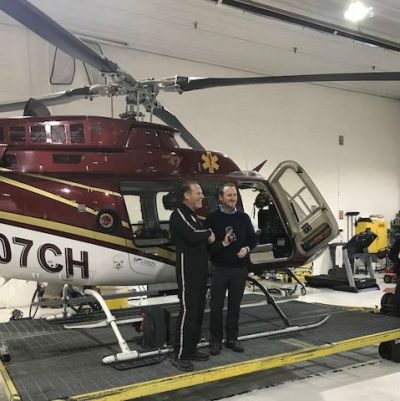 Matt Stein and Tony Henderson celebrate the milestone in front of a Bell 407. Classic Air Medical Photo
