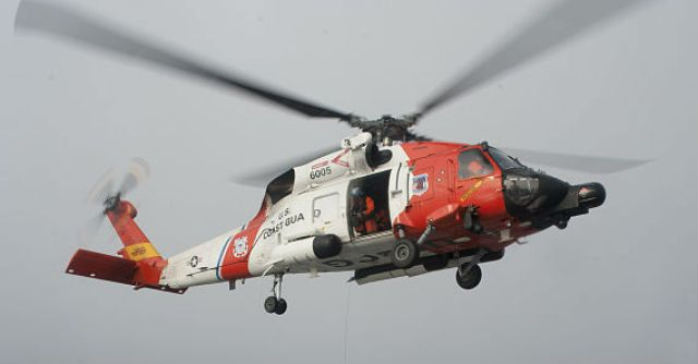 A Coast Guard Air Station Kodiak MH-60 Jayhawk helicopter hoisted a man from the Snowy vessel off the coast of Alaska, as he suffered from appendicitis. Wikimedia Commons Photo
