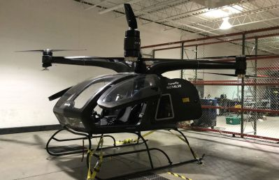 SureFly is the first electric hybrid helicopter, and it is able to carry two passengers with a range of approximately 70 miles. Workhorse Group Photo
