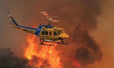"""Ventura County Aviation Unit's Copter 7, a Bell 205 """"Super Huey,"""" led the initial nighttime attack of the devastating Thomas Fire. Skip Robinson Photo"""