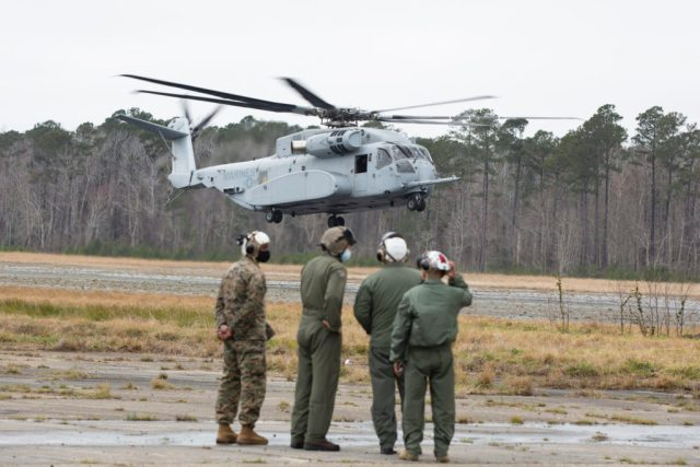 Marines watch a CH-53K King Stallion prepare to land at Marines Corps Outlying Field (MCOLF) Camp Davis, North Carolina, March 17, 2021. U.S. Marine Corps photo by Lance Cpl. Yuritzy Gomez.