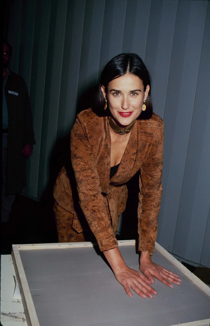 demi moore's beauty evolution, from short hair to buzz cuts