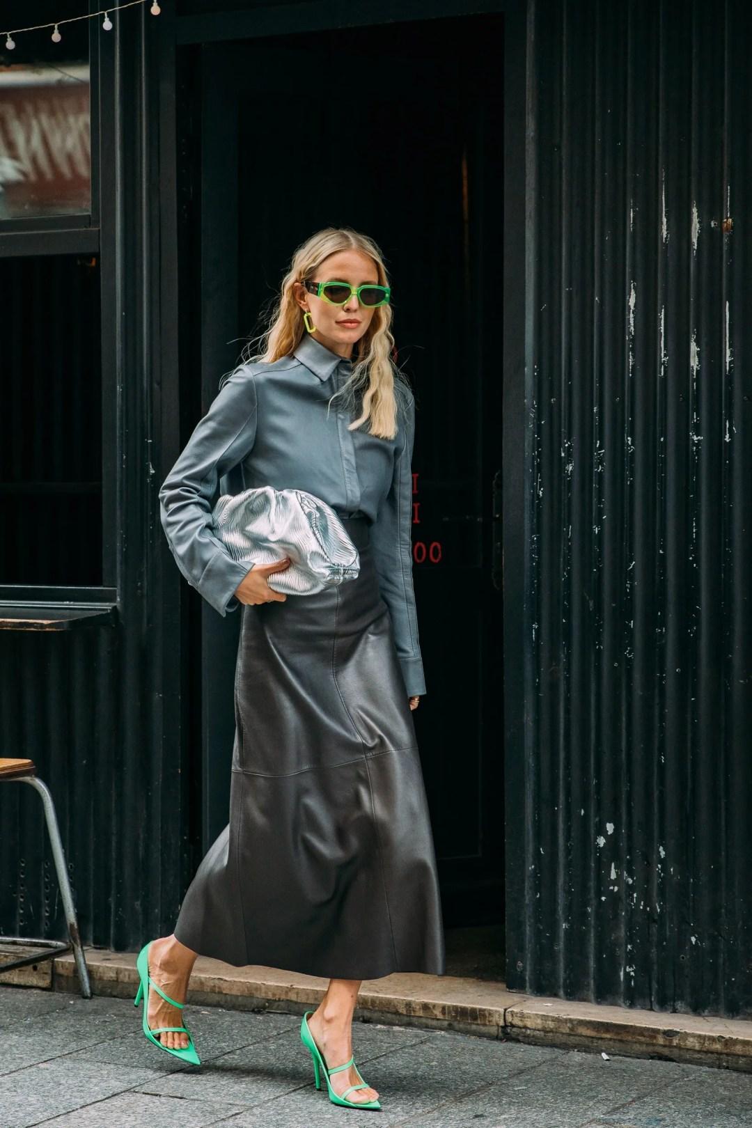Leonie Hanne carries Bottega Veneta in Paris.