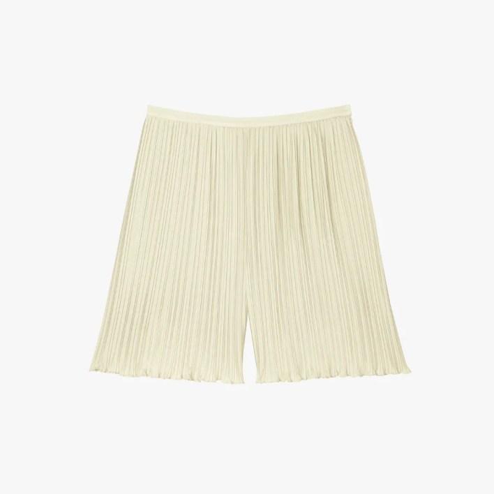 Image may contain: Clothing, Shorts, Apparel, and Lamp