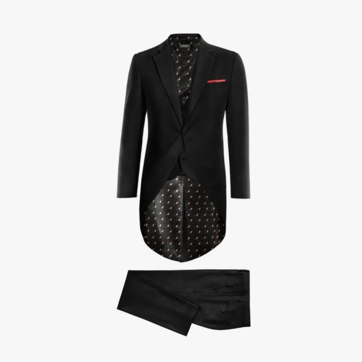 Image may contain: Suit, Coat, Clothing, Overcoat, Apparel, Tuxedo, Jacket, Blazer, and Dress