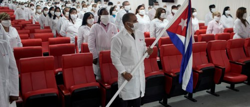 Cuban doctors listen to speeches during a farewell ceremony before departing to Kuwait to assist, amid the coronavirus disease (COVID-19) outbreak, in Havana, Cuba June 4, 2020. REUTERS/Alexandre Meneghini - RC2K2H9S3CTE