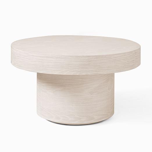 volume round pedestal coffee table wood