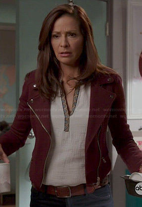 Regina's white split neck top and burgundy moto jacket on Switched at Birth