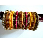 yellow-pink-silk-thread-bangles-with-stones-dull-finish-gold-plated-bangles-with-stones-bridal-bangles