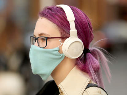 woman with headphones, mask