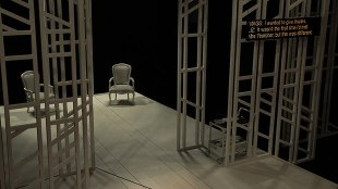 a stage in a theatrical performance. There is a chair in the middle and some metal frames that depict a sort of a wall. To the right is an electronic screen that is displaying captions.