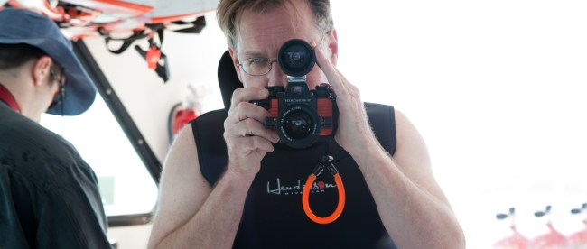 Bruce seeing through the viewfinder of his camera.