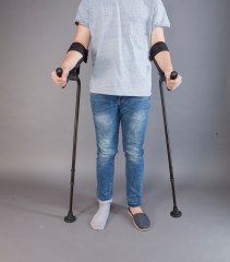 a person using two KMINA crutches