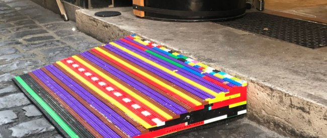 A colorful wheelchair ramp made from lego bricks