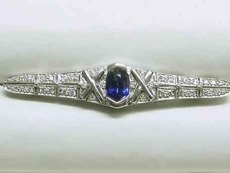 p-130 Sapphire pin with diamonds, 18K white gold