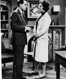Mr. Dawson (Charles Tingwell) discusses a problem with Dr. Frances Whitney (Paula Byrne).