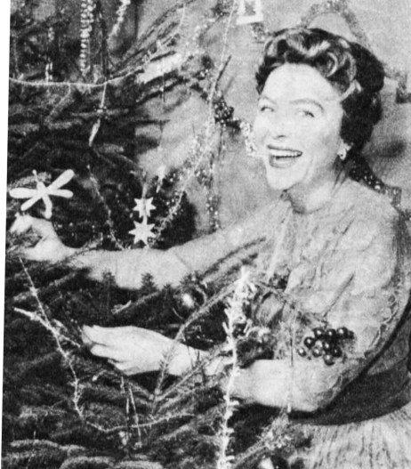 Noele Gordon decorates the Christmas tree