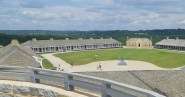 View of the Fort Snelling Parade Ground from the top of the Round Tower. Buildings include, from left, Wood Barracks, Commanding Officers' Quarters and Officers' Quarters. (c) J.S. Reinitz 2014