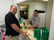 Our Trustee Jim Cosgrove serves up some suds to Field Agent George Hayes.